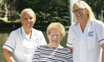 Better Healthcare carers with a patient
