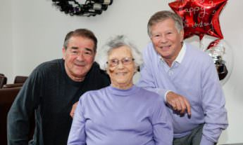 Our patients are happy with the care we give them - two senior men and one senior woman smiling.
