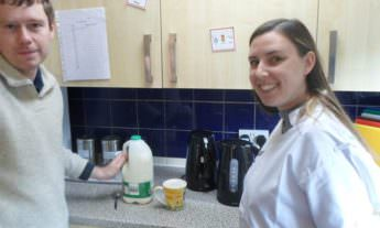 Home care - carer with patient in the kitchen