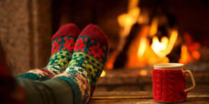 Feet-in-Christmas-socks-by-fire