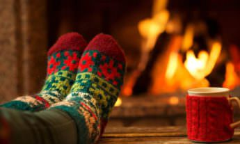 Christmas time-feet in festive wooly socks by fire-reminiscence therapy