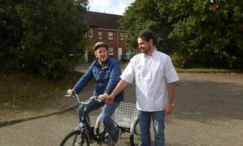 Care worker with patient riding a bike