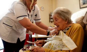 BHCS carer helping patient eat