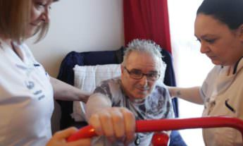 Better Healthcare carers helping a patient