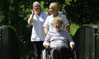 Carers walking with patient